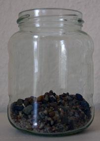 grober Sand im Glas