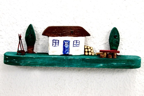 Haus mit Lagerfeuer
