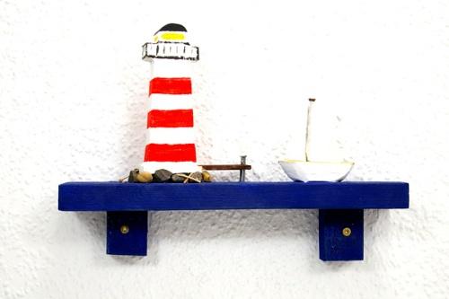 Leutturm  mit Boot