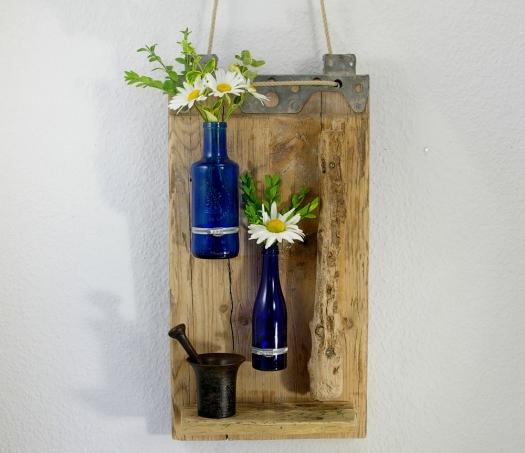geruestbrett blaue flaschen front
