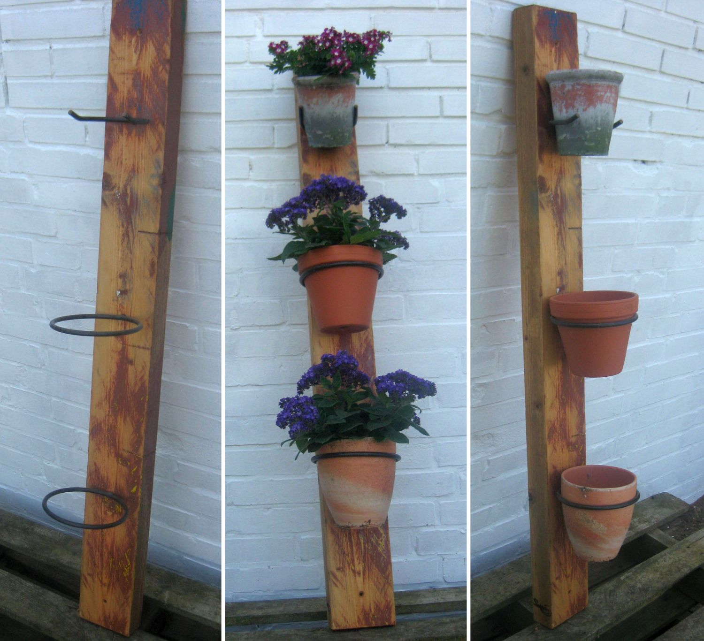 Schöne Metallhaken vom Schmied eignen sich hervorragend zum Aufhängen von Blumentöpfen