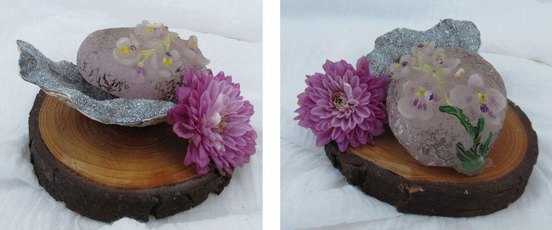 Tischdekoration mit bunter Muschel und Blume